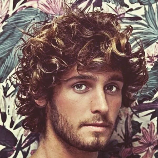Medium Length Hairstyles for Guys with Curly Hair 1