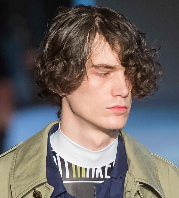 Medium Length Hairstyles for Guys with Curly Hair 3