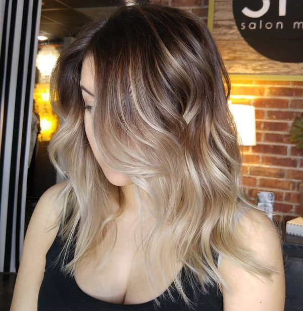 Girls with highlights in wavy brown hair 3